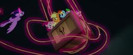 Twilight Sparkle wraps rope around the crate MLPTM