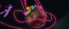 Twilight Sparkle wraps rope around the crate MLPTM