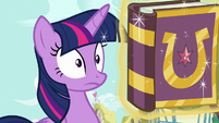Twilight with a friendship journal in her face S7E14
