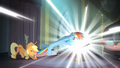 Applejack trying to pull Rainbow out of the comic book S4E06.png