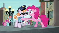 Pinkie Pie shaking the police officer S6E3