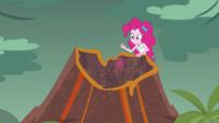 Pinkie drops a glowing rock into the volcano EGDS1