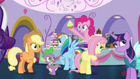Pinkie pops out and presents a cupcake S5E14