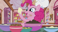 Pinkie taking a bit of the cocoa-flavored buttercream S5E8