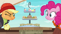 Applejack and Pinkie look at Rarity's platter S6E22