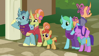 Villagers wave goodbye; Sable Spirit walks away S7E16