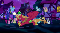 Alicorn Big McIntosh flies past the crowd S5E13