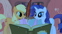 Applejack and Rarity looking at Twilight's book S1E08