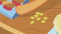 Applejack collecting bits S01E03.png