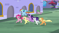 Mane Six and Spike racing through Canterlot S9E1