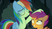 Rainbow Dash pats Scootaloo on the head S7E16