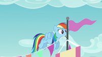 Rainbow Dash putting up decorations S5E24
