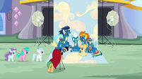 The Wonderbolts at a photo shoot for foals S7E7
