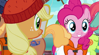 AJ and Pinkie look at line of porter ponies S6E22