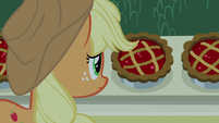 Applejack looking at the food S9E17