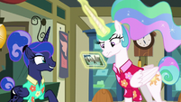 Celestia looking at Luna's postcard S9E13