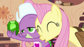Fluttershy nuzzles Spike S03E11.png