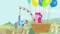 Pinkie pulls Rainbow using a fishing rod S4E12