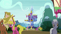 Ponies mingle outside the Castle of Friendship S6E1.png