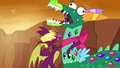 A dragon hugs Twilight in the dragon costume S2E21.png