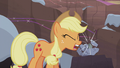Applejack making a Hearth's Warming rock doll S5E20.png