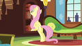 Fluttershy pulls out a book from the shelf S5E5.png