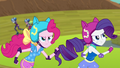 Pinkie and Rarity in focus with Sunny Flare and Lemon Zest out of focus EG3.png