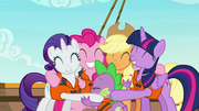 Ponies and Spike share a group hug S6E22
