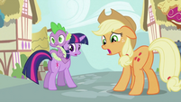 Twilight, Spike and Applejack looking behind S2E06