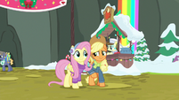 Applejack nudges Fluttershy with her elbow MLPBGE