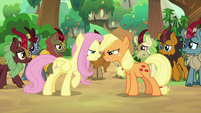 Fluttershy and AJ arguing among the Kirin S8E23