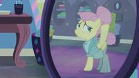 Fluttershy securing her mane bun S8E4