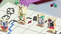 Spike sets down Captain Wuzz character stand S6E17