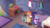 Sunset Shimmer sits next to Twilight EG4