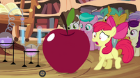 Apple Bloom next to growing apple S4E15