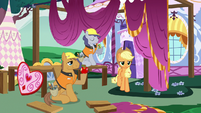 Applejack walking past construction ponies S7E9