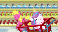 Flurry Heart riding a cart past Cherry Berry S7E3