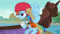 Rainbow Dash holding a bunch of oars S8E9