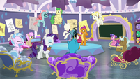 Smolder burns a dress in Rarity's class S8E2