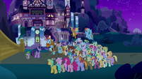 Twilight, Rockhoof, and students outside castle S8E21
