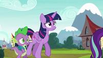 Twilight and Spike follow Starlight Glimmer S5E26