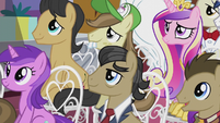 Assorted ponies listening to the mayor S5E9