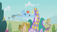 Rainbow Dash flying over Ponyville S1E05