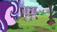Starlight Glimmer approaches Trixie's wagon S9E20