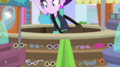 Starlight Glimmer jumps inside the sunglasses kiosk EGS3.png