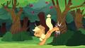 Applejack bucking an apple tree S6E18.png
