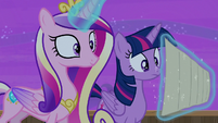 Princess Cadance holds the schedule with her magic S7E22