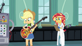 Applejack looks at her bass EG3.png