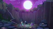 Queen Chrysalis flies away in the night S8E13