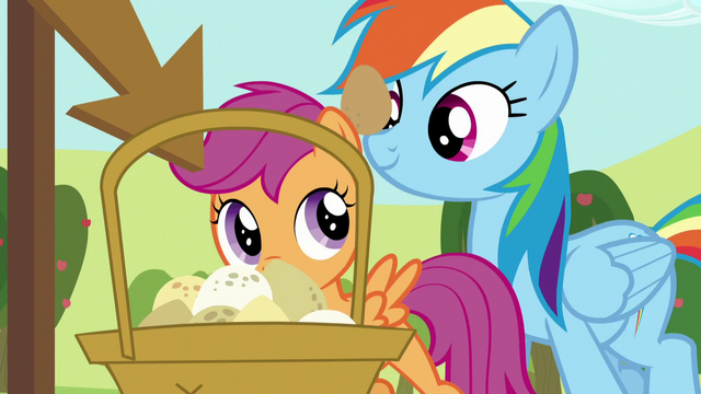 File:Rainbow and Scootaloo set their eggs down S5E17.png